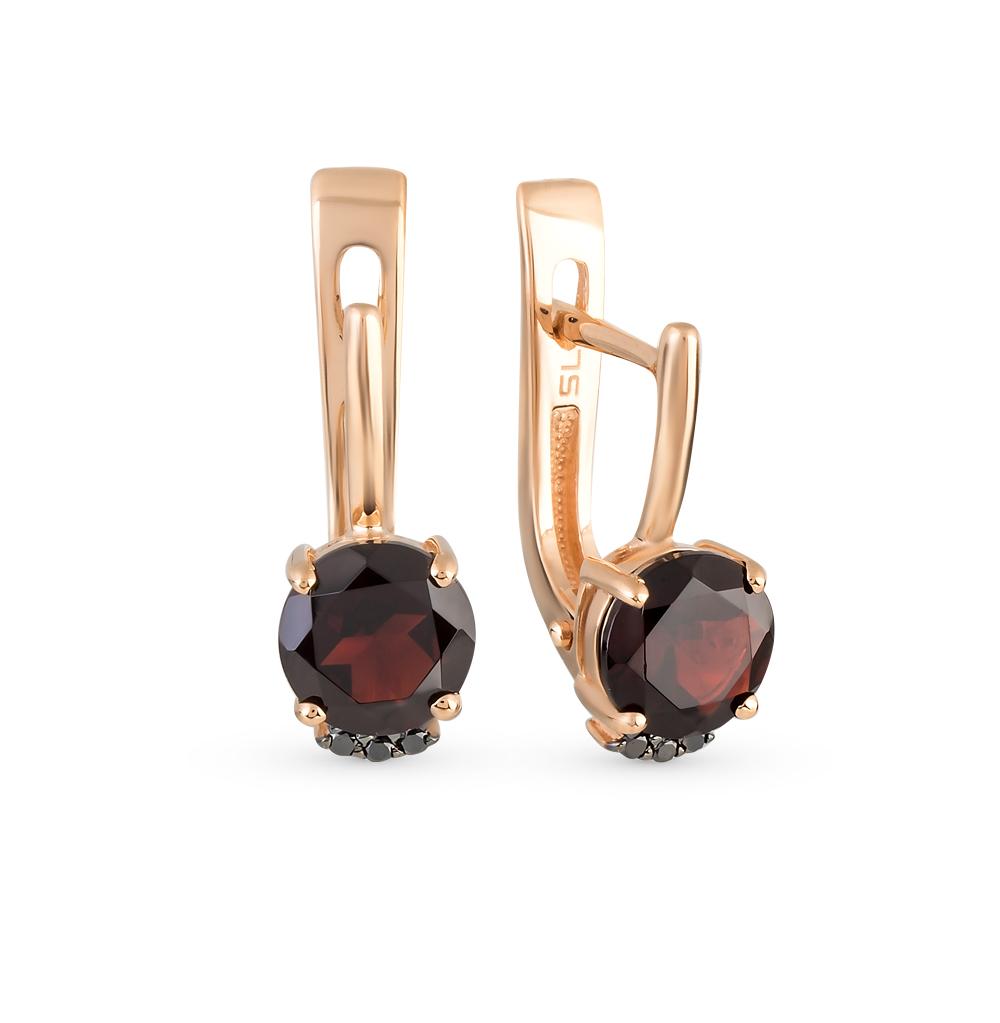Фото «золотые серьги с чёрными бриллиантами и гранатами»
