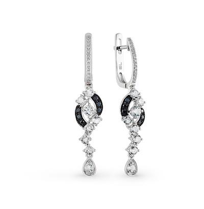 Фото «золотые серьги с чёрными и белыми бриллиантами и топазами»